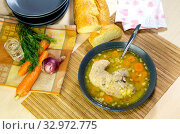 Купить «The pea soup with pork in a plate on the table close-up», фото № 32972775, снято 24 августа 2015 г. (c) Татьяна Ляпи / Фотобанк Лори