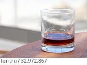 Купить «Spiced dark Caribbean rum in a glass», фото № 32972867, снято 15 января 2020 г. (c) EugeneSergeev / Фотобанк Лори