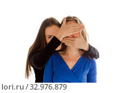 Lady hiding face of anonymous woman with hands. Стоковое фото, фотограф Ekaterina Demidova / Фотобанк Лори