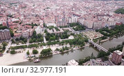 Купить «Aerial view of Valladolid cityscape with a modern apartment buildings, Spain», видеоролик № 32977191, снято 20 июня 2019 г. (c) Яков Филимонов / Фотобанк Лори