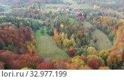 Купить «Scenic autumn country landscape with colorful trees on hillsides and empty fields», видеоролик № 32977199, снято 18 октября 2019 г. (c) Яков Филимонов / Фотобанк Лори