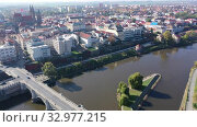 Купить «Aerial view of autumn Kolin cityscape on Elbe River overlooking medieval Gothic Cathedral of St. Bartholomew, Czech Republic», видеоролик № 32977215, снято 14 октября 2019 г. (c) Яков Филимонов / Фотобанк Лори