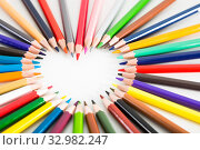 Купить «colored pencils lying around the heart», фото № 32982247, снято 11 января 2017 г. (c) Татьяна Яцевич / Фотобанк Лори