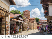 Church of John the Baptist (11th century) and souvenir shops in Old Town of Nessebar (2019 год). Редакционное фото, фотограф Юлия Бабкина / Фотобанк Лори