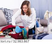 Купить «Woman packing for holiday», фото № 32983867, снято 22 марта 2017 г. (c) Яков Филимонов / Фотобанк Лори