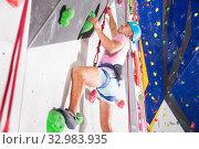 Купить «Man dressed in rock climbing at bouldering gym», фото № 32983935, снято 25 февраля 2020 г. (c) Яков Филимонов / Фотобанк Лори