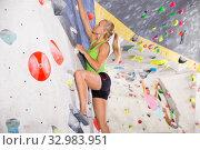 Купить «Female climbing artificial rock wall», фото № 32983951, снято 9 июля 2018 г. (c) Яков Филимонов / Фотобанк Лори