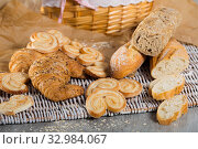 Купить «Various bakery products on rattan mat», фото № 32984067, снято 30 января 2018 г. (c) Яков Филимонов / Фотобанк Лори
