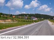 Купить «Landscape with a village and a road in the north Montenegro», фото № 32984391, снято 14 июня 2019 г. (c) Володина Ольга / Фотобанк Лори