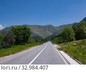 Купить «Landscape with road in the north Montenegro», фото № 32984407, снято 14 июня 2019 г. (c) Володина Ольга / Фотобанк Лори