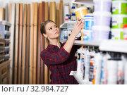 Купить «Female designer is looking paint», фото № 32984727, снято 16 февраля 2018 г. (c) Яков Филимонов / Фотобанк Лори