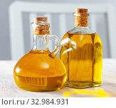 Vegetable oil on wooden table. Стоковое фото, фотограф Яков Филимонов / Фотобанк Лори