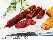 Купить «Raw smoked salami with fresh rosemary», фото № 32984951, снято 3 апреля 2020 г. (c) Яков Филимонов / Фотобанк Лори
