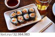 Купить «Sushi roll maki with salmon. Japanese cuisine», фото № 32984983, снято 3 апреля 2020 г. (c) Яков Филимонов / Фотобанк Лори