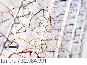 Купить «Glasses showcase in modern optic shop», фото № 32984991, снято 27 августа 2019 г. (c) Яков Филимонов / Фотобанк Лори