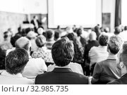 Купить «Business speaker giving a talk at business conference event.», фото № 32985735, снято 30 сентября 2019 г. (c) Matej Kastelic / Фотобанк Лори