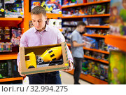 Купить «Interested adult man looking for big toy car», фото № 32994275, снято 9 апреля 2020 г. (c) Яков Филимонов / Фотобанк Лори