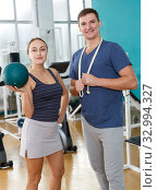 Купить «Man and woman posing standing at gym», фото № 32994327, снято 5 ноября 2018 г. (c) Яков Филимонов / Фотобанк Лори