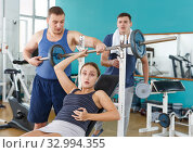 Girl injured during exercising with barbell. Стоковое фото, фотограф Яков Филимонов / Фотобанк Лори