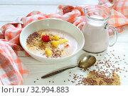 Yogurt with flax seeds, grapefruit, raspberries and orange on a white background. Стоковое фото, фотограф Марина Володько / Фотобанк Лори