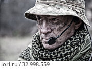 Купить «Close-up portrait of brutal commando veteran, experienced army commander or officer with dirty face, wearing camouflage bonnie, shemagh, tactical radio headset with microphone, looking in camera.», фото № 32998559, снято 26 ноября 2017 г. (c) easy Fotostock / Фотобанк Лори