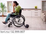 Купить «Young male invalid in wheel-chair suffering at home», фото № 32999807, снято 23 июля 2019 г. (c) Elnur / Фотобанк Лори