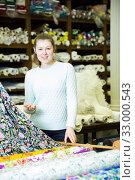 Купить «Salesgirl working in fabric store», фото № 33000543, снято 2 марта 2018 г. (c) Яков Филимонов / Фотобанк Лори
