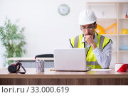 Купить «Young male architect working in the office», фото № 33000619, снято 1 августа 2019 г. (c) Elnur / Фотобанк Лори