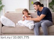 Купить «Father taking care of his ill daughter», фото № 33001775, снято 6 августа 2019 г. (c) Elnur / Фотобанк Лори