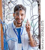 Купить «Electrician trying to untangle wires in repair concept», фото № 33002075, снято 7 июля 2017 г. (c) Elnur / Фотобанк Лори