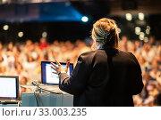 Купить «Public speaker giving talk at Business Event.», фото № 33003235, снято 8 сентября 2016 г. (c) Matej Kastelic / Фотобанк Лори
