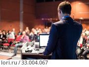 Купить «Public speaker giving talk at business event.», фото № 33004067, снято 16 февраля 2020 г. (c) Matej Kastelic / Фотобанк Лори