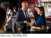 Купить «Man enjoying conversation with female colleague», фото № 33006551, снято 25 марта 2019 г. (c) Яков Филимонов / Фотобанк Лори