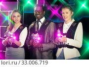 Купить «Smiling associates – afro man and two European women posing at», фото № 33006719, снято 4 апреля 2019 г. (c) Яков Филимонов / Фотобанк Лори