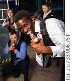 Купить «Men and women in business suits playing laser tag emotionally in dark room», фото № 33006751, снято 4 апреля 2019 г. (c) Яков Филимонов / Фотобанк Лори
