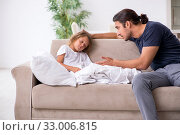 Купить «Father taking care of his ill daughter», фото № 33006815, снято 6 августа 2019 г. (c) Elnur / Фотобанк Лори