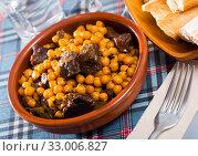 Купить «Tasty beef stew with chickpeas closeup», фото № 33006827, снято 5 июля 2020 г. (c) Яков Филимонов / Фотобанк Лори