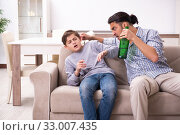 Купить «Drunk father and his son», фото № 33007435, снято 21 мая 2019 г. (c) Elnur / Фотобанк Лори