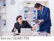 Купить «Boss and his male assistant working in the office», фото № 33007759, снято 7 февраля 2019 г. (c) Elnur / Фотобанк Лори
