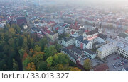 Купить «Scenic aerial view of historical centre of Jihlava in autumn gauze overlooking belfries of St. James and St. Ignatius churches and red steeple of Town Hall, Czech Republic», видеоролик № 33013327, снято 14 октября 2019 г. (c) Яков Филимонов / Фотобанк Лори