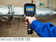 Купить «thermal imaging inspection of heating equipment», фото № 33018135, снято 25 февраля 2019 г. (c) Дмитрий Калиновский / Фотобанк Лори