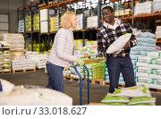 Купить «Mature woman and man stacking bags on trolley», фото № 33018627, снято 14 ноября 2019 г. (c) Яков Филимонов / Фотобанк Лори