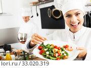 Купить «Female chef preparing fresh salad», фото № 33020319, снято 24 февраля 2020 г. (c) Яков Филимонов / Фотобанк Лори