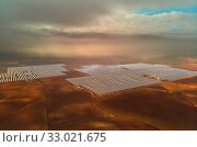Купить «Aerial image drone point of view photo Gemasolar Concentrated solar power plant CSP, system generate solar power using mirrors lenses to concentrate large area of sunlight onto receiver, Seville Spain», фото № 33021675, снято 18 декабря 2019 г. (c) Alexander Tihonovs / Фотобанк Лори