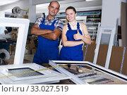 Smiling workers posing in assembly shop of windows. Стоковое фото, фотограф Яков Филимонов / Фотобанк Лори