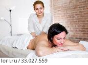Купить «Professional masseuse is doing massage of back and loin to adult woman», фото № 33027559, снято 7 марта 2017 г. (c) Яков Филимонов / Фотобанк Лори
