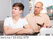 Купить «Man scolding son at home», фото № 33032979, снято 7 апреля 2019 г. (c) Яков Филимонов / Фотобанк Лори