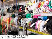 Купить «Colored ribbons on needlework store shelves», фото № 33033247, снято 18 октября 2019 г. (c) Яков Филимонов / Фотобанк Лори