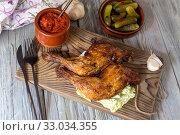 Купить «Fried chicken legs on a cutting board close-up», фото № 33034355, снято 5 февраля 2020 г. (c) Татьяна Ляпи / Фотобанк Лори