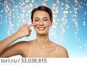 Купить «beautiful smiling woman showing her nose», фото № 33038815, снято 30 ноября 2019 г. (c) Syda Productions / Фотобанк Лори